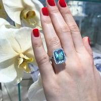 Matthew_Ely_Aquamarine_Diamond_Halo_Ring.jpg