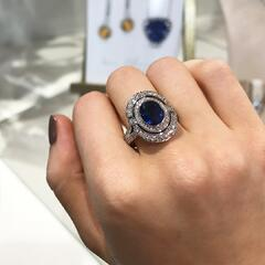 Matthew_Ely_Jewellers_Oval_Blue_Sapphire_And_Brilliant_Cut_Diamond_Ring.jpg