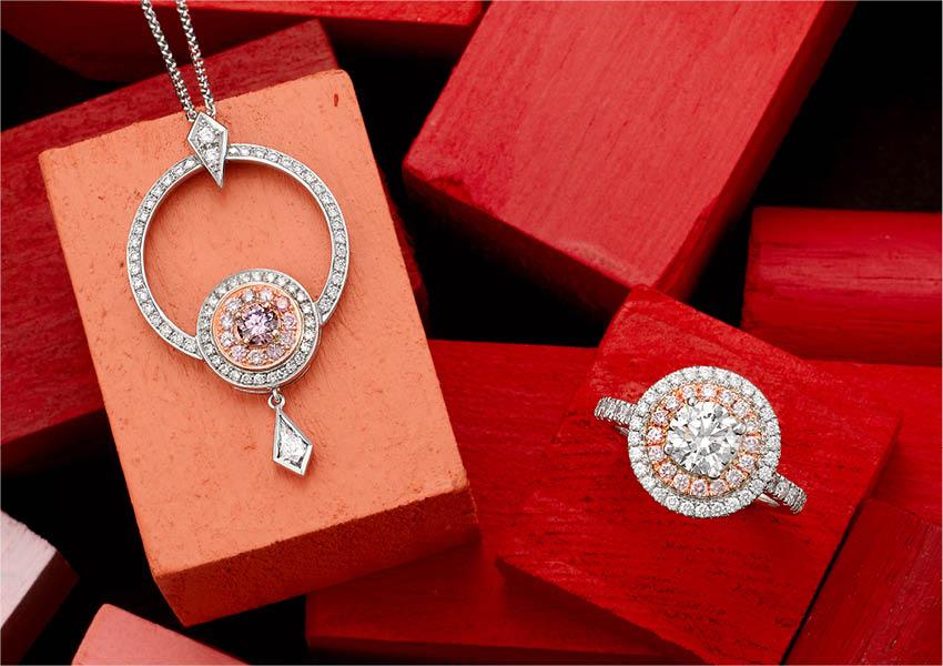 Matthew_Ely_Pink_Diamond_Friendship_Pendant_And_Brilliant_Cut_Argyle_White_And_Pink_Diamond_Ring.jpg